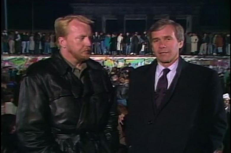 NBC News anchor Tom Brokaw exclusively covers the fall of the Berlin Wall live